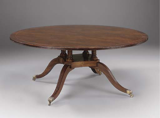 A mahogany circular dining tab