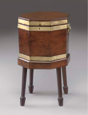 AN OCTAGONAL MAHOGANY AND BRAS