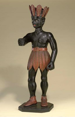 A CARVED WOOD AND POLYCHROME T