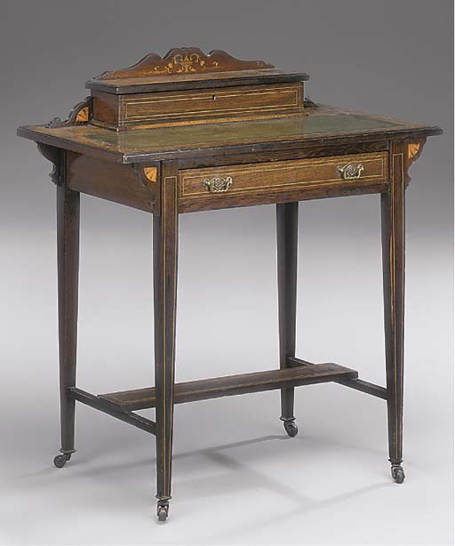 A LATE VICTORIAN ROSEWOOD AND INLAID WRITING TABLE