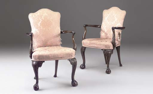 A PAIR OF MAHOGANY OPEN ARMCHAIRS