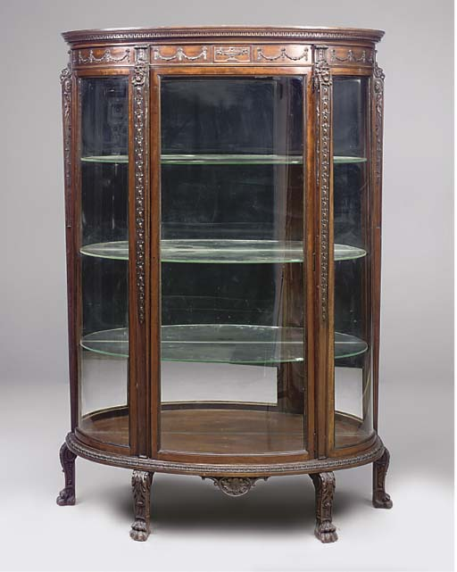 A CARVED MAHOGANY BOWFRONT DISPLAY CABINET