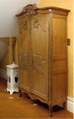 A NORMANDY PINE ARMOIRE