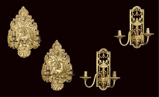 A PAIR OF REPOUSSE BRASS WALL