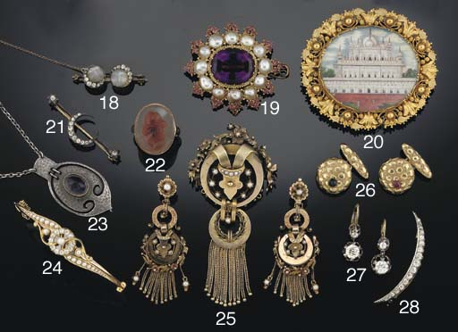 An early 19th century amethyst, blister pearl and ruby brooch