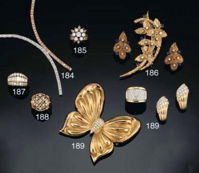 A diamond butterfly brooch, a