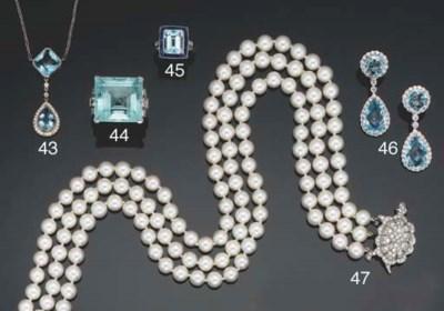 An aquamarine, sapphire and di