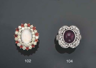 An opal, diamond and garnet cl