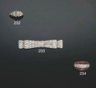 A diamond cluster bow-brooch