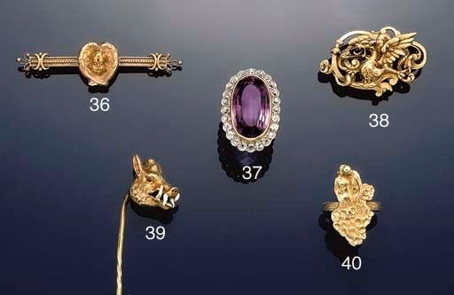A gold figural ring by René La