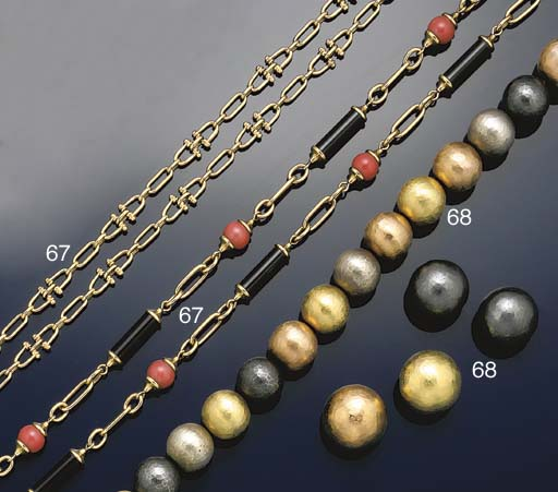 A bi-metallic necklace and two