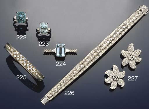 An aquamarine and diamond bar