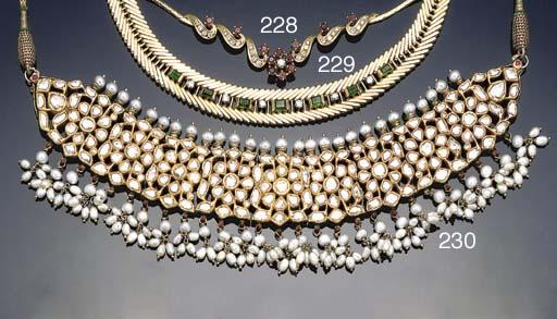 An emerald and diamond set nec
