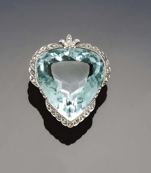 An early 20th century aquamarine and diamond brooch/pendant