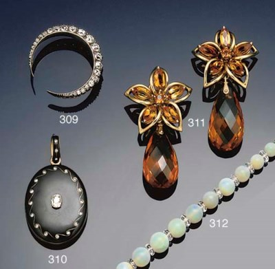 A pair of citrine drop earclip