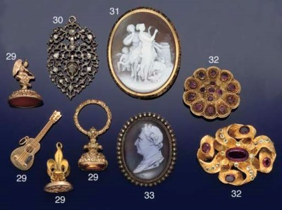 A group of fob seals and charm