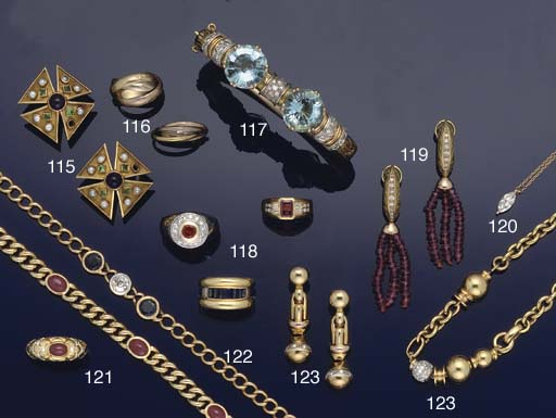 A diamond set necklace and ear