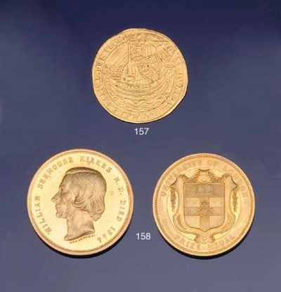 Two gold medical prize medals