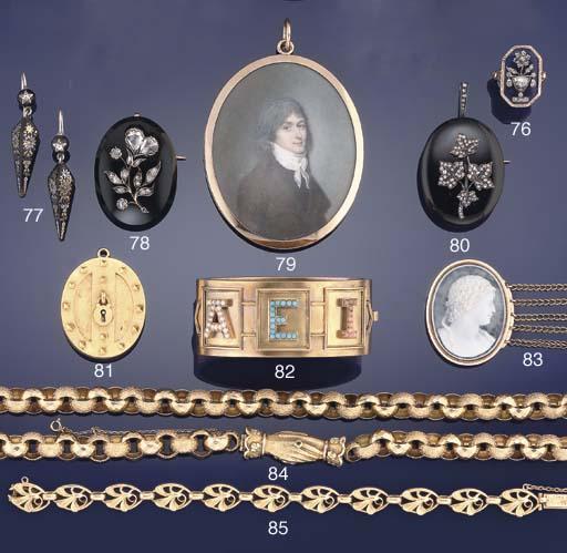 A late 19th century onyx and rose-cut diamond brooch/pendant
