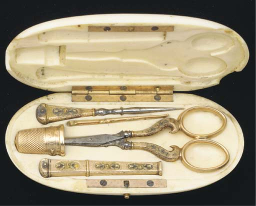 AN IVORY CASED GOLD SEWING SET