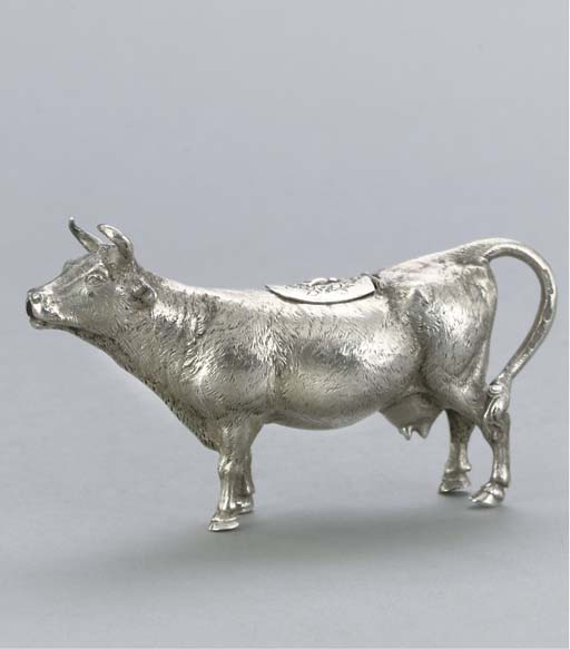 A GERMAN SILVER COW CREAMER