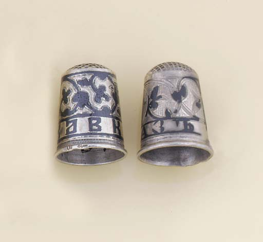 A SILVER NIELLOED THIMBLE AND