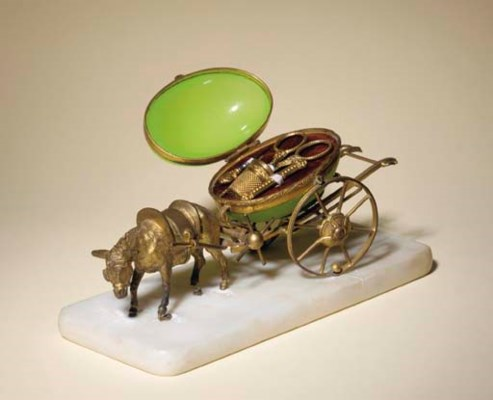 A GILT-METAL DONKEY AND CART