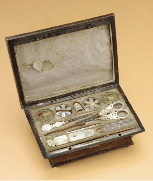 A WOODEN SEWING BOX