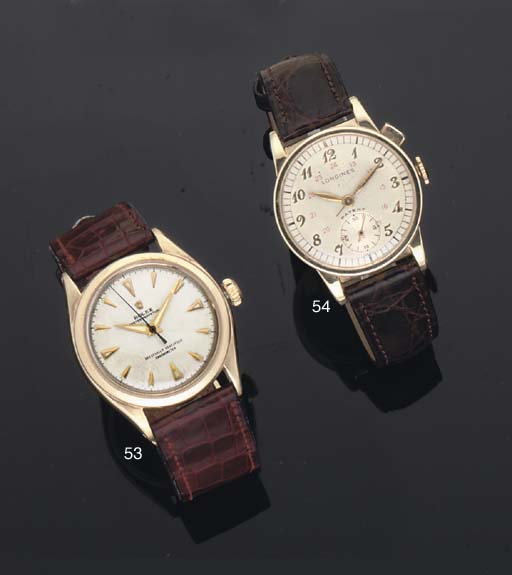 Longines. A 14ct Gold Stop Centre Seconds Wristwatch