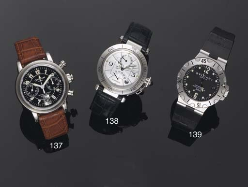 Cartier. A Stainless Steel water Resistant  Automatic Centre Seconds dual time Wristwatch with power reserve and calendar