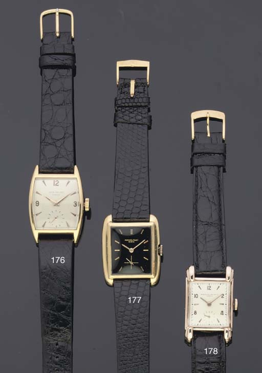 Patek Philippe. An 18ct Gold Tonneau Shaped Curved Back Wristwatch
