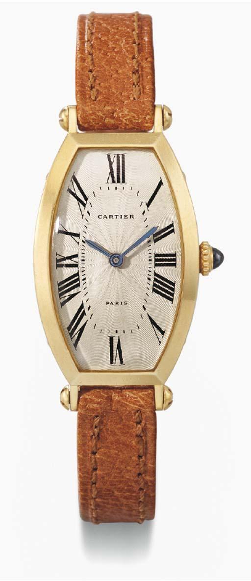 Cartier. An 18K gold tonneau-s