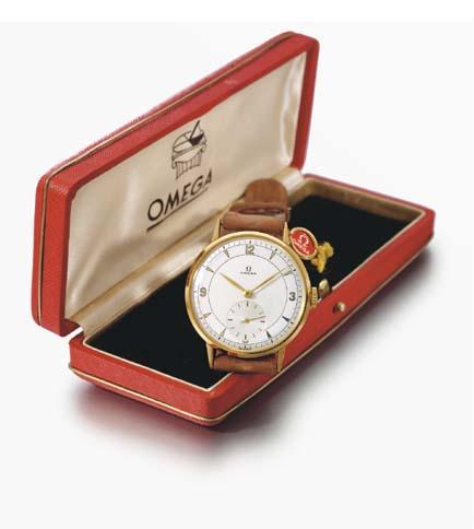 Omega. An 18K gold wristwatch