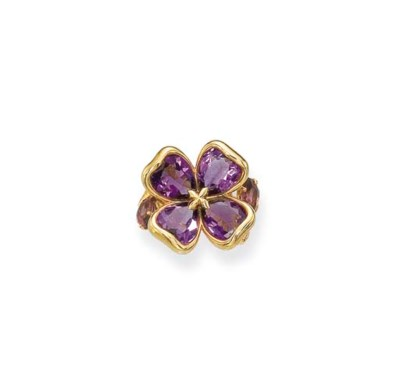 AN AMETHYST FLORAL RING, BY CH