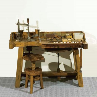 A LAPIDARY BENCH AND STOOL