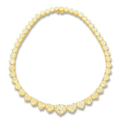 AN IMPORTANT YELLOW DIAMOND RI