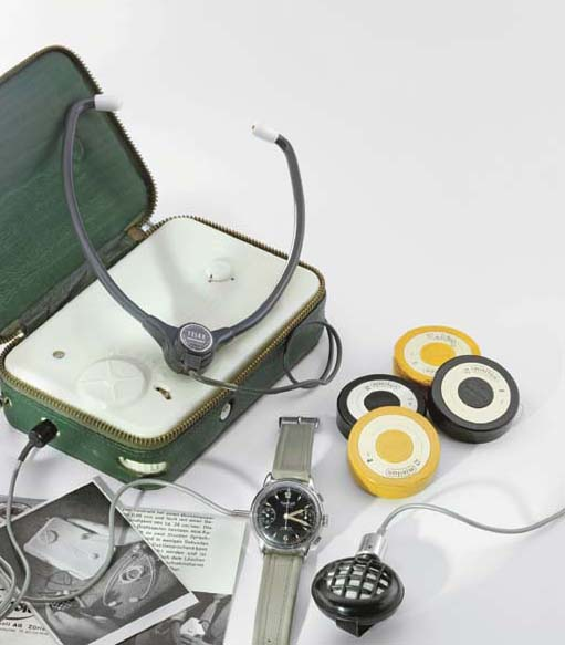 Protona. An unusual Minifon pocket size magnetic wire recorder and chromed wrist microphone, resembling a chronograph wristwatch by Hanhart