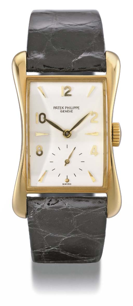 Patek Philippe. A fine and rare rectangular-shaped 18K gold wristwatch with flared sides
