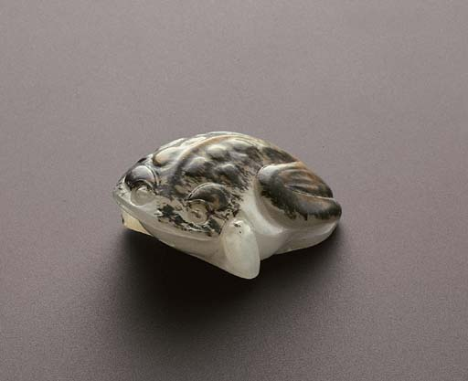 A WHITE AND RUSSET JADE TOAD P