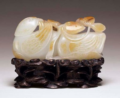 A FINELY CARVED WHITE JADE 'MA