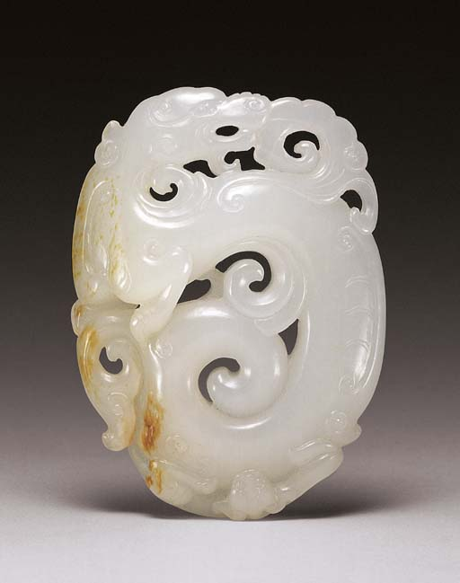 A FINE LARGE WHITE JADE 'DRAGO
