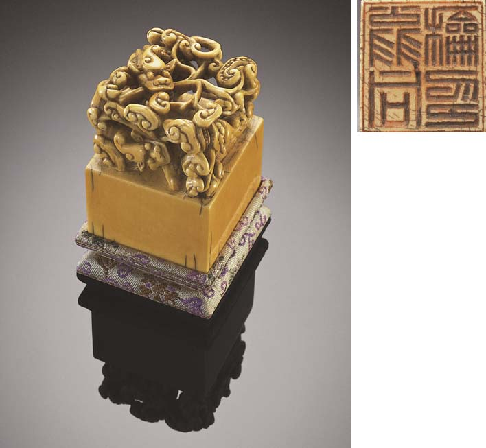 A CARVED IVORY 'CHILONG' SEAL