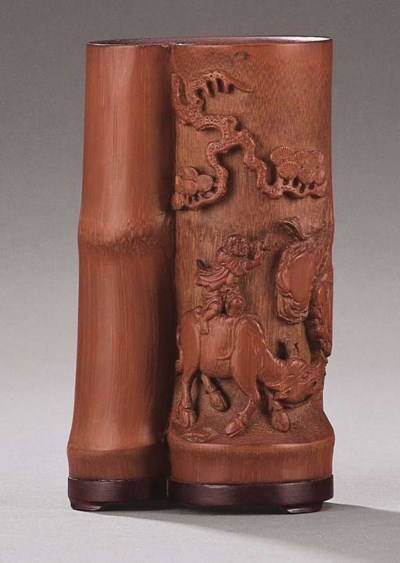 A SMALL CARVED BAMBOO BRUSHPOT