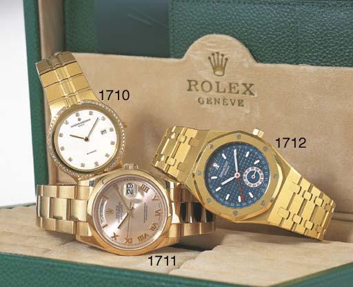 ROLEX. AN 18K PINK GOLD SELF-W