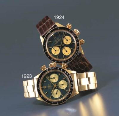 ROLEX. A 14K GOLD CHRONOGRAPH