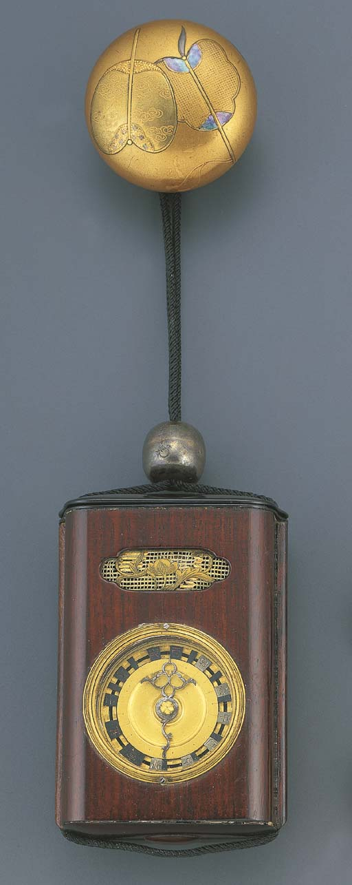 JAPANESE. A BRASS AND WOOD STR