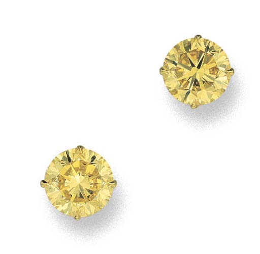 AN IMPORTANT PAIR OF FANCY VIVID YELLOW DIAMOND EAR STUDS