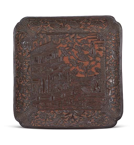 A VERY RARE CARVED BROWN LACQU