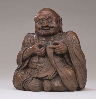A RARE BAMBOO FIGURE OF AN AGE