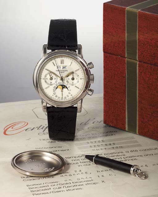 PATEK PHILIPPE. A FINE 18K WHITE GOLD PERPETUAL CALENDAR CHRONOGRAPH WRISTWATCH WITH PHASES OF THE MOON